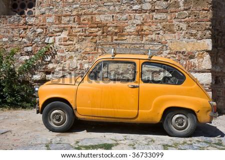 Small eastern european car near an old church in ohrid macedonia