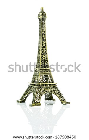Small Eiffel tower isolated on over white background