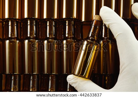 Small empty brown glass bottles on hand