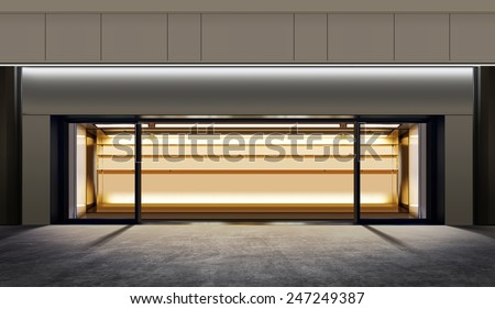 small empty shop on the city street at night