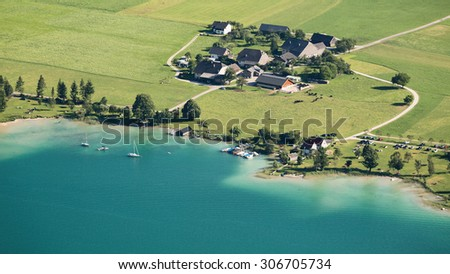 Small farming community at lake Wolfgangsee in Austria. Aerial view by summer.
