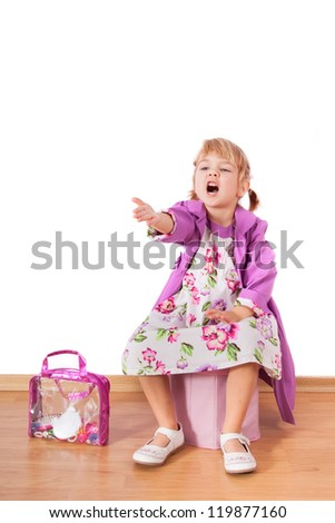 Small fashion girl sitting and shouting to the public - stock photo