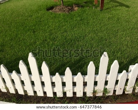 Small Fence Around The Garden In Morning