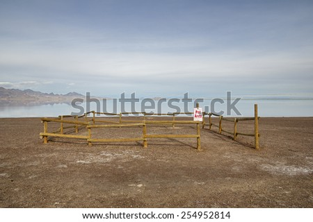 small fenced off gravel pet area near the flooded Bonneville Salt Flats - stock photo