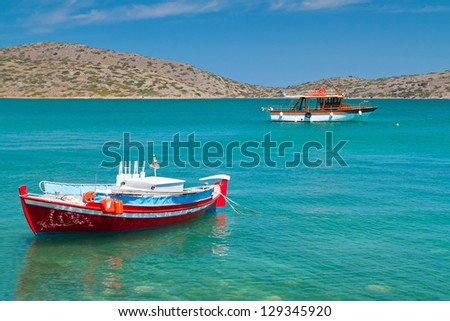 Small fishing boat at the coast of Crete, Greece - stock photo