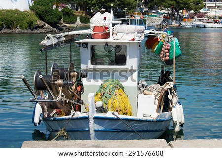 Small fishing boat in a port - stock photo