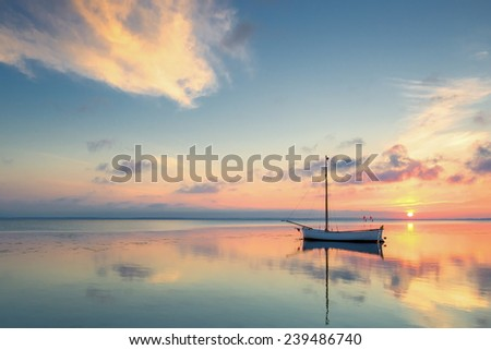 Small fishing boat, on the beach, of Baltic sea, Poland - stock photo