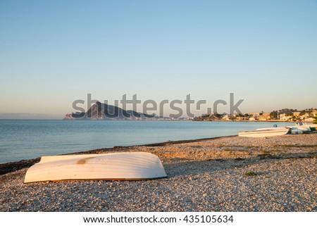 Small fishing boats ashore under early morning sun, Altea, Costa blanca, Spain - stock photo
