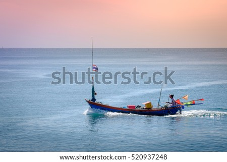 Small fishing boats heading out to sea to catch fish, shrimp, mussels, Thailand.