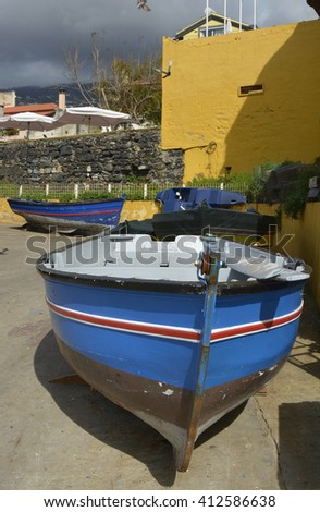 Small fishing boats on the seafront at Funchal in Madeira, Portugal - stock photo