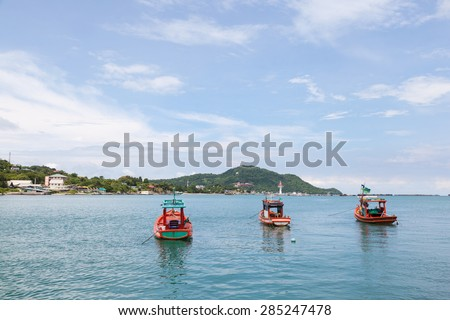 Small fishing boats Parking in the sea near the island dock. - stock photo