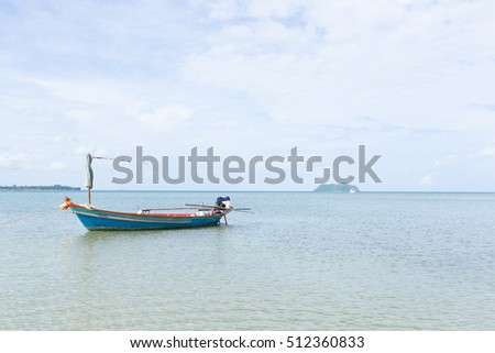 Small fishing boats. Parking on the sea beach. In the daytime sky