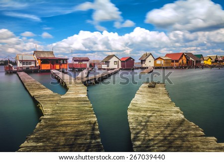 Small fishing cottages on Bokod lake in Hungary - stock photo