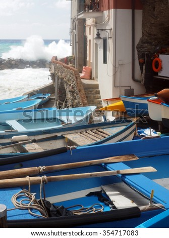 small fishing row boats on land during rough sea Rio Maggiore Cinque Terre Italy Europe