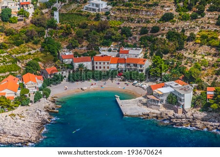 Small fishing village on the south part of the Peljesac peninsula with sandy beach in the center, in Dubrovnik archipelago, Croatia. - stock photo