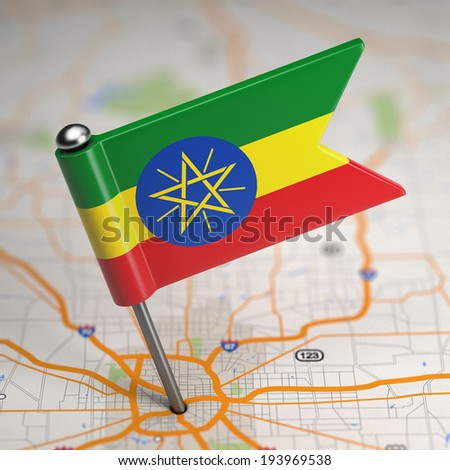 Small Flag Federal Democratic Republic of Ethiopia on a Map Background with Selective Focus. - stock photo