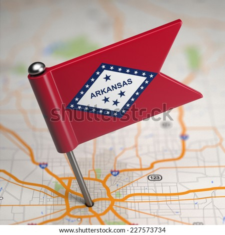 Small Flag of Arkansas on a Map Background with Selective Focus. - stock photo