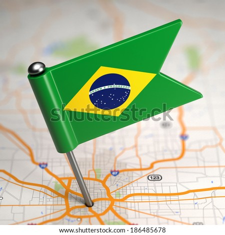 Small Flag of Brazil Sticked in the Map Background with Selective Focus. - stock photo