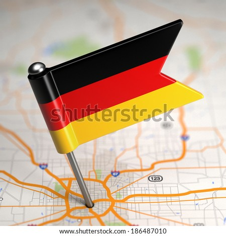 Small Flag of Federal Republic of Germany on a Map Background with Selective Focus. - stock photo