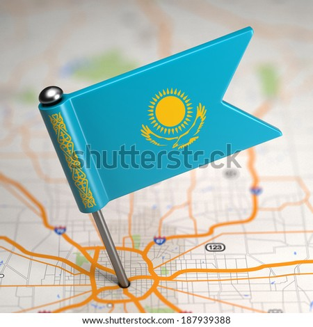 Small Flag of Kazakhstan on a Map Background with Selective Focus. - stock photo