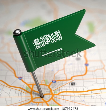 Small Flag of Saudi Arabia on a Map Background with Selective Focus. - stock photo