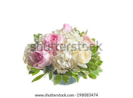 Small flower arrangment for the table full of roses and hydrangea - stock photo