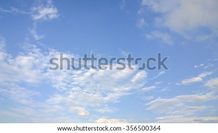 small fluffy cloud on sky - stock photo