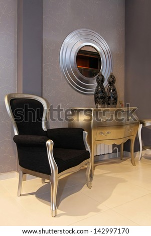 Small foyer interior with silver and black furniture