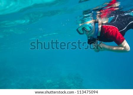 small freediver - stock photo