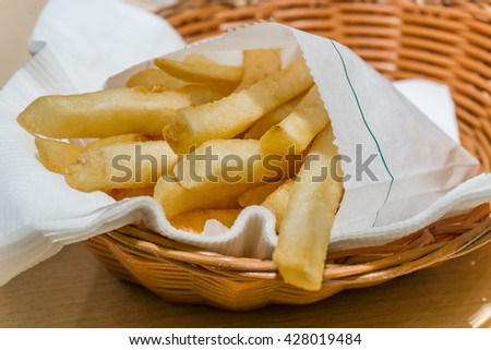 Small french fries in a basket - stock photo