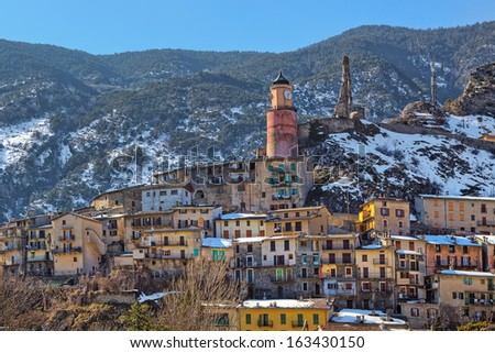 Small french town of Tende on the mountains slope in Alps, France. - stock photo