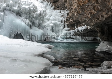 Small frozen waterfall in the canyon