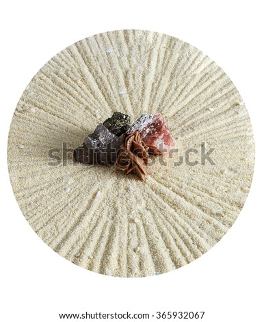 Small garden of stones in the form of the sun on a white background