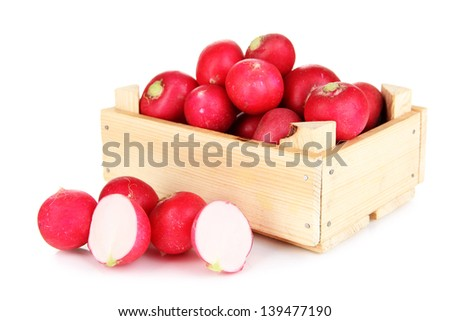 Small garden radish in wooden box isolated on white