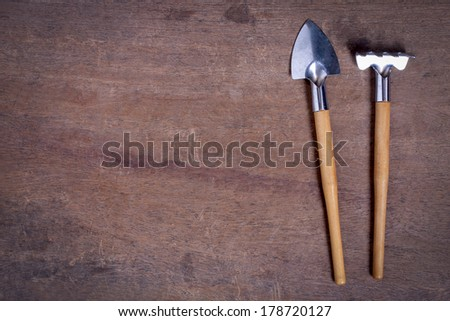 Small Gardening Tools on wooden table with copy space