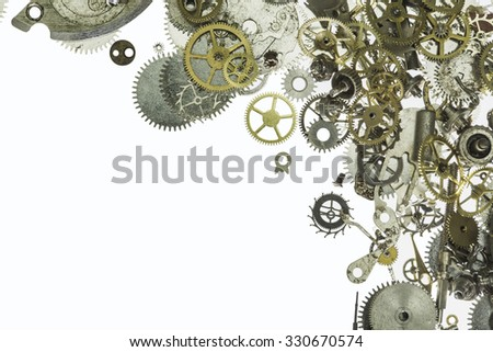 small gearwheels parts of analog clock isolated on white background - stock photo