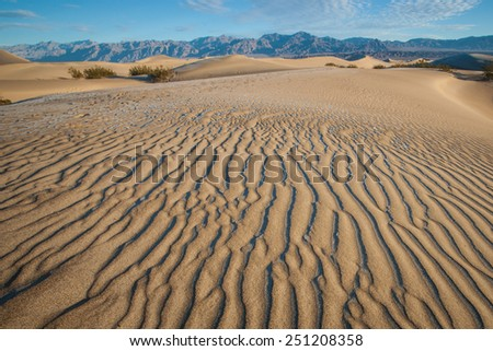 Small geometric sand formations form on the dunes near Stovepipe Wells in Death Valley. - stock photo