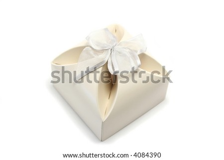 small gift box in cream cardboard with a silvery bow - often used for wedding favours - stock photo