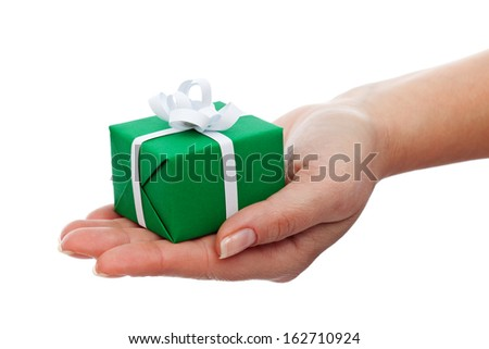 Small gift box in woman hand - christmas present, isolated - stock photo