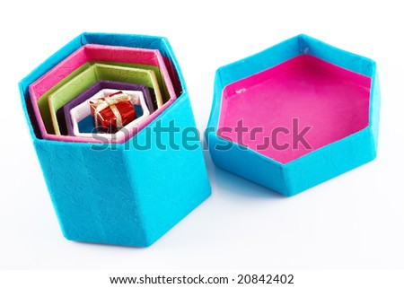 small gift hidden in colorful boxes