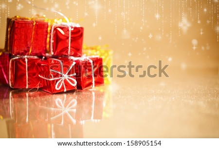 small gift packages for christmas on shiny reflective surface