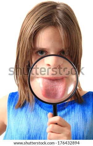 small girl and magnify glass - stock photo