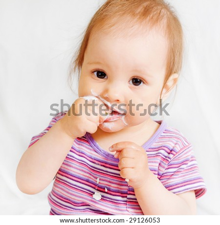 Small girl eating some food with hands