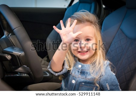Small girl in exhibition room for car
