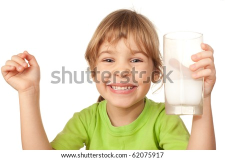 small girl in green blouse laugh and drinks tasty fresh milk - stock photo
