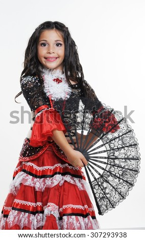 Small girl in red costume and a fan in her hand