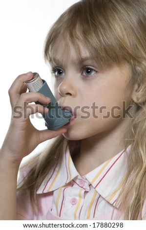 Small girl inhaling a medicine