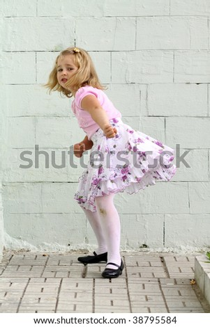 Small girl playing outdoor in park