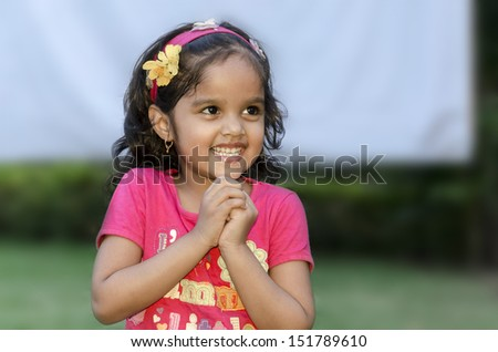 Small girl playing outdoors. - stock photo