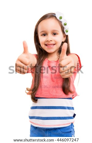 Small girl showing thumbs up, isolated over white background